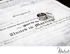Wedding rings & the marriage certificate in black & white.  Photos by Michael's Photography in Bensalem, PA.