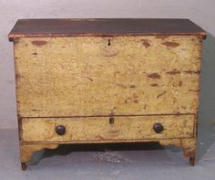 Primitive blanket chest. A few old, distressed pieces gives a home character and soul. I love mixing old with new.