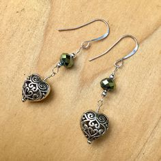 These green Celtic Heart earrings feature green Swarovski crystals , puffy pewter hearts and sterling silver wire, ear wires, and accent beads. A great gift for Valentines Day or any day. Fast shipping from Portland, Oregon with no sales tax. Your item will arrive in a gift bag wrapped in
