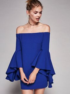 Australian made off-the-shoulder mini dress with an elastic band at the neckline for an easy fit. Statement flared sleeve with a dramatic cuff.
