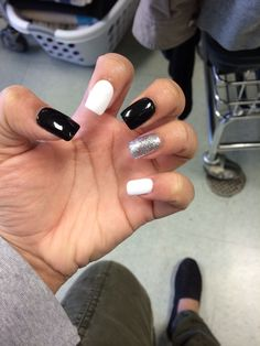 Simple black, white, and sliver nails.