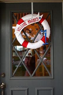 nautical party life preserver wreath.  Use a pool noodle.