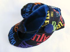 Elegant baby booties made from Beatles fabric by bootki on Etsy