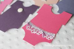 Baby girl shower decoration idea: cut onesies out on colored paper and snazz them up with ribbon, buttons, stickers, and more!