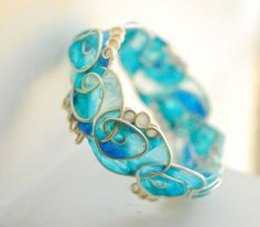 Artisan Wearable Art Paper Jewelry, Taylor's Eclectic: Statement Jewelry, Sterling Silver Surf Bangle in Blues and White, Spirals; on etsy