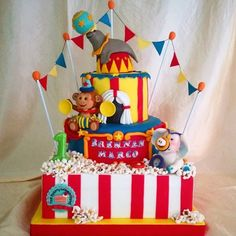 - Circus Themed Decorative Three Tiered Cake with Sugar Animal Figurines on Top!  TAG a Cake Lover! - Cake by: @thepastrywonderland