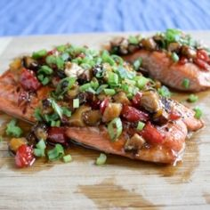 Salmon topped with a glaze of bell peppers, shiitake mushrooms, ginger, honey, soy sauce, and scallions. And, of course, a dash of Sriracha!