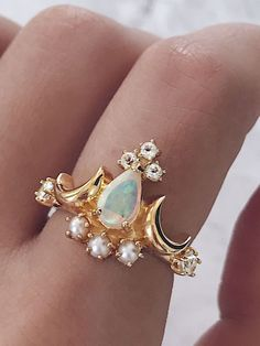 White opal ring. Beautiful white opal designs in gold or silver, that can be worn as a cocktail ring or stacked together as stacking rings. Hand-set with sparkling diamonds or pearls, these white opal vintage rings or modern opal bands are perfect as an engagement ring or wedding ring. For opal lovers who love white opal jewelry and the gorgeous opalescence and iridescence of white opal stones. Shop opal jewellery and opal rings at AU REVOIR LES FILLES