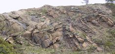 Metamorphic Petrology; In the field, ultramafic rocks are mostly seen in the basal sections of ophiolites and as exhumed pieces of the upper mantle. Here's a famous outcrop at Helgehornvatnet in Norway