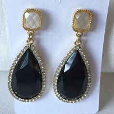 Black acrylic teardrop crystal dangle earrings These earrings are perfect for a wedding that little black dress when you want to add some pizzazz to any outfit. They measure 2 1/2 inches long and 7/8 inches wide at the widest point. Jewelry Earrings