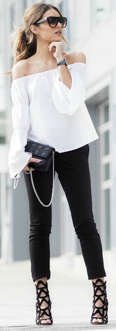 Lydia Lise Millen + classic off the shoulder blouse + elegant and sophisticated + monochrome style + black cigarette trousers + black sandals  Top: Boohoo, Trousers: Joseph, Bag: Dior, Shoes: Sophie Webster.