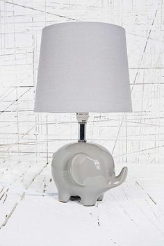 """Elephant Lamp UK Plug in Grey """"Make the darkness completely irrelephant with this ceramic lamp. Boasting a mega-cute elephant base and a circular linen shade, this is the perfect addition to any stylish home."""" Do you understand how important this is??? 100% nonnegotiable."""