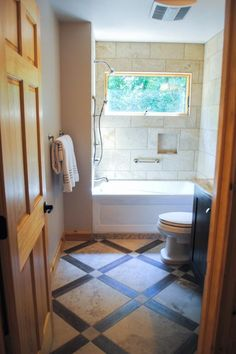 HGTV invites you to take a look at this rustic guest bathroom with an elegant tile shower.