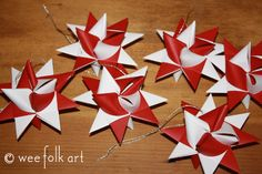 Danish woven stars - I make dozens of these each year but I haven't tried the 2 color... off to cut more paper :-)