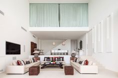 Double-height ceilings and an open living room, which leads out to the terrace and gardens, create an expansive feel.