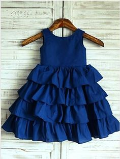 Navy Blue Cotton Cupcake Knee Length Flower Girl Dress - The dress is made of high quality cotton fabric.The listed color is navy blue,many other colors are available as well.The skirt is cupcake style and in knee length.We used 3 wood buttons to de Kids Dress Wear, Girls Blue Dress, Little Girl Dresses, Girls Dresses, Flower Girl Dresses, Flower Girls, Baby Flower, Toddler Girl Dresses, Baby Girl Dress Patterns