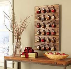 Make an Advent calendar using a wood board, a few decorative ornaments, and paper tags.