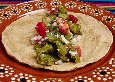 Cactus (Nopal) salad topped with crumbled ranchero cheese, a great Mexican vegetarian dish.