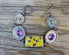 Mixed gemstone bracelet. Atlantisite bracelet with amethyst & peridot. Large statement purple green gemstone bracelet. Peridot bracelet. by ForestBook on Etsy https://www.etsy.com/listing/245859801/mixed-gemstone-bracelet-atlantisite