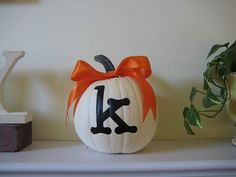 monogrammed pumpkin... apartment idea for Halloween next year