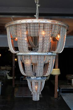 17 Inspirational DIY Ideas to Enlighten Your Home With Upcycling Home Items...this is a bike chain chandelier!!