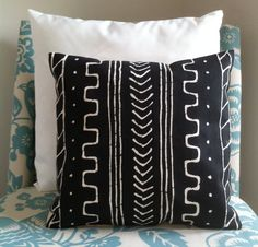 This interesting batik pillow cover was created completely by hand - hand stitched and hand painted - borrowing from several ethnic mudcloth