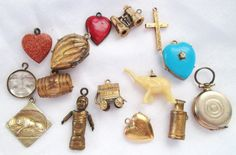 LOT OF 15 ANTIQUE & VINTAGE CHARMS - LOCKETS, BINOCULARS, WAGON, LION, ETC | eBay, sold for $86,90 Ca. EUR 63,53