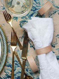 """DIY● Wrap Wood Veneer as Napkin Rings- DIY wooden napkin rings. Create the rings by snipping pieces of adhesive wood veneer to size -- one 6-1/2 inches long and another 8-1/2 inches. Lay the pieces' adhesive sides toward each other and iron into place (avoid the exposed edge on the 8-1/2-inch piece). Curl the exposed edge of the longer piece of veneer to meet the opposite end and gently hold it against the iron; this will create what looks like an uppercase """"D"""" shape, which prevents the ring…"""