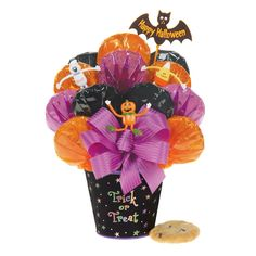 All treats and no tricks! This bouquet of 12 assorted gourmet cookies, along with three bendable Halloween characters, is frightfully cute and delicious!