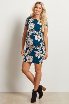 With a simply stunning rose floral print, this fitted maternity dress will be your new go-to this year as a transitional mom. Dress for any occasion, day or night, with this chic ensemble. This dress will keep any mom comfortable for work or play and can be dressed up with a statement necklace and heels for a stunning ensemble.