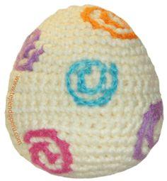Huevo de Pascua tejido con un solo color y bordado de espirales en crochet