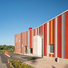 Colourful metal cladding extends across the front of this daycare centre in the Finnish city of Espoo, which encloses a secluded playground Dezeen Architecture, School Places, Metal Cladding, Metal Buildings, Different Colors, Centre, Stairs, Exterior, Kindergarten