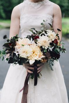 Autumn bridal bouquet grown and designed by Love 'n Fresh Flowers.  Cream and black dahlias.