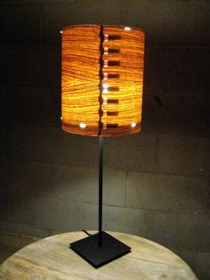 Wood veneer lamp. Would make in to great wall lamps. Find out where to get veneer.