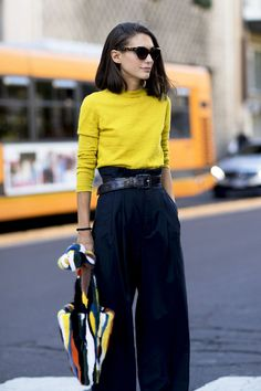 milan fashion week street style spring 2018 diletta bonaiuti yellow sweater navy high waist pants multi colored fuzzy bag