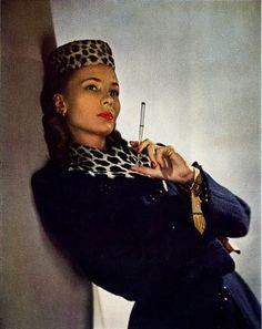 1942 Harper's Bazaar. Leopard .Cigarette holder . 1940's fashion