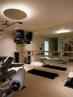 Exercise room with ballet mirror/bar.