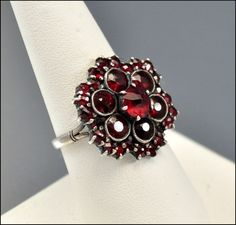 Some day I will own Bohemian garnet jewelry. *sigh*  Edwardian Bohemian Garnet Ring Antique Jewelry Silver Cluster Vintage 1900s. From Boylerpf, via Etsy.