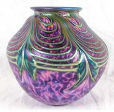 David Lotton art glass vase, c.1994; purple lava style with pulled feather pattern.