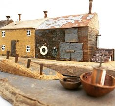 No photo description available. Driftwood Crafts, Wooden Crafts, Driftwood Ideas, Little Cottages, Little Houses, Pebble Painting, Painting On Wood, Ceramic Houses, Wood Houses