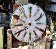 Garden tool outdoor clock, how about a galvanized garbage can lid for this - Modern