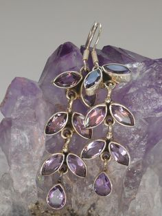 "Each Amethyst gemstone earring has 7 faceted teardrop Amethyst gemstones, set in 925-hallmarked sterling silver. Matching pendant available separately. Earring Length: 1.5"" Width; 5"""