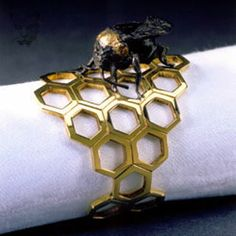 Martin Bakker Bee Napkin Ring Hand pierced, gold plated silver napkin ring with wax modelled and cast gold plated and oxidised silver bee.  Dimensions: 44mm