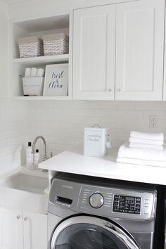 @jshomedesign home laundry room, white subway tile, white quartz countertop, patterned tiles