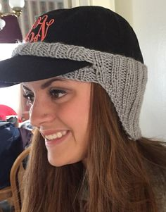 Free knitting pattern for Baseball Hat Ear Warmer  The brim of your baseball hat fits through the slit in Susan Snyder's ear warmer design to keep your ears warm when you're wearing your favorite hat. Other knitters have adapted for riding helmets and driving caps. Pictured project by CraftyDeb