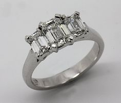 18ct White Gold Emerald cut Diamond trilogy Engagement ring.