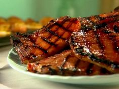 Sunny grills smoked pork chops with a simple sweet and sour glaze for a finger-licking addition to any barbecue. Sponsored by Pork Be inspired®.