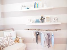 Exposed hanging clothing storage below a shelf. I wouldn't use a stick, but I do really like this idea since we're short on closet space.