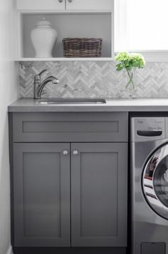 Laundry room with herringbone tile backsplash, herringbone tiles, (calcutta marble herringbone tiles) Laundry Room Design, Laundry In Bathroom, Laundry Area, Small Laundry, Basement Laundry, Laundry Closet, Grey Laundry Rooms, Budget Bathroom, White Bathroom