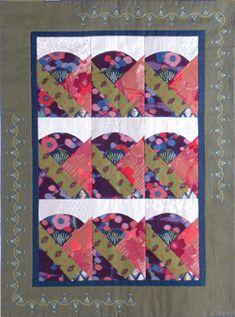 """Fan"" quilt in sashiko pattern. A geisha's hand, hidden in her kimono sleeve, holds a fan."